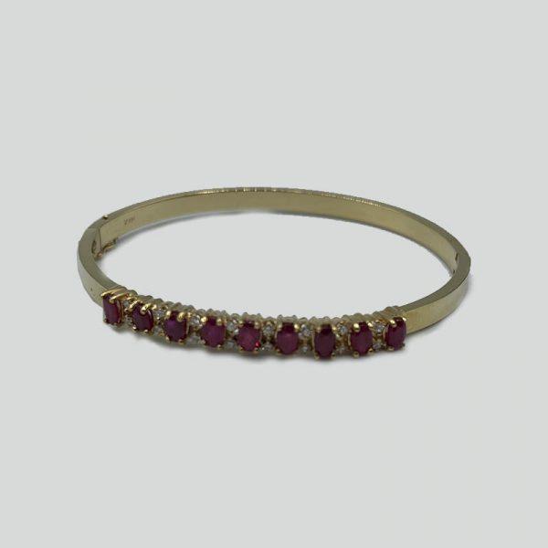 Diamond bangle with rubies