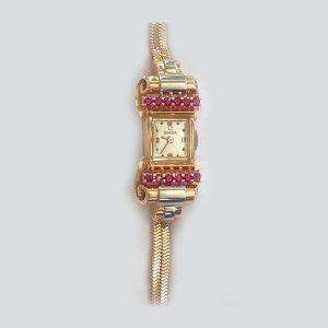 ruby, gold and platinum wristwatch